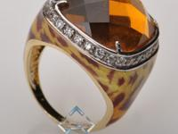 Beautiful tawny leopard print enamel forms the setting