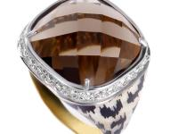 This gemstone ring is a bold and striking piece. It is