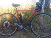 Road bike with good shimano components. Rides good and