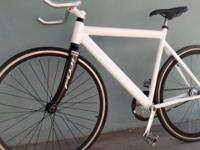 Road bike with Fuji Carbon Forks. Front wheel is