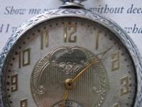 This lovely antique pocket watch has a lovely dial as
