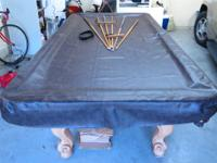 This is a beautiful Robertson billiard pool table,
