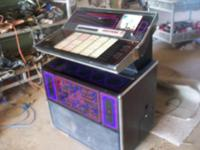 1970's Roc Ola Juke Box. Plays 45's . Needs key to open