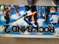 Offering a complete Rock Band set for the Xbox 360.