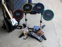 Rock band game for PS2 and PS3 included are drum set,