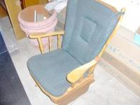 Wood rocker/glider with green paded seat and back. Some