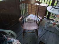 Medium dark wood rocking chair. Please note: there is a