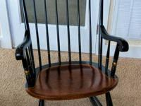 Black Classic Rocking Chair with gold trim. A beautiful