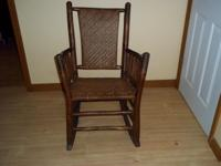 VERY NICE ANTIQUE ROCKING CHAIR. $200.00. GOOD