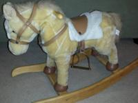 Battery operated horse makes noises and moves head back