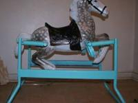 Dapple gray, newly refinished rocking horse. One of a