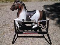 Large spring rocking horse. In great condition.