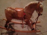 vintage rocking horse has real tail/ hair saddle and