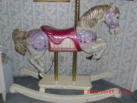 Exquisite hand made Rocking Horse in running position.