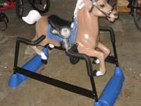 Barely ridden spring rocking horse with electronic