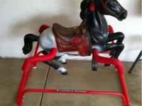This is a Flexible flyer rocking horse in great shape.
