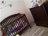 Selling a cherry wood crib set and dresser, about one