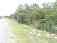 2 lots boasting mature Live Oak trees + a just a couple