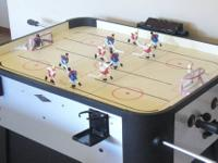 The rod hockey table is manufactured by Classic Sport.