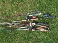 Set of assorted rods and couple reels and one net