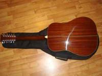 I have a practically new rogue 12 string guitar for