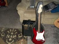 Red six string electric guitar., good condition