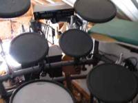 Older Roland Electronic drum set. Works great. TD7 with
