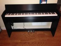 88-key digital piano with weighted keys and 3 pedals.
