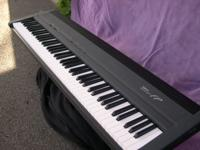 Roland FP-8 Digital piano, grey in color. 88 keys with
