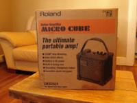 Lightweight and portable Roland Micro Cube Amp. Hardly