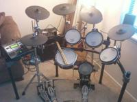 Roland TD-12S Electronic Drum Set. Has around 50