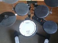 Compact electric drum kit with mesh head snare,