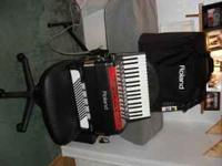 (electronic) accordion & case. 96 bass--34 keys. soft