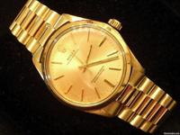 THIS IS A VERY IMPRESSIVE GENUINE ROLEX SOLID 14K GOLD