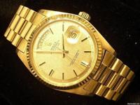 This is a very handsome mens Rolex solid 18k gold