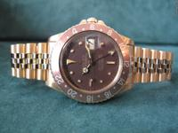 This is a Rolex, 1973 Vintage Yellow Gold GMT Root Beer