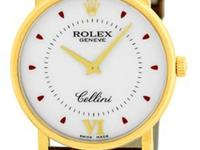white/silver dial with roman numeral and brown hour