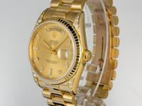 For sale is an excellent condition 36mm 18 karat yellow