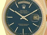 royal blue dial with raised gold baton markers,