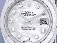 factory white mother-of-pearl dial with diamond hour