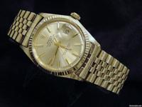 The original solid 18k yellow gold case with 18k fluted