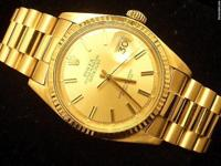 This mens Rolex solid 18k gold oyster perpetual
