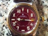 Men's unisex Rolex/Tudor watch. The bezel and stem are