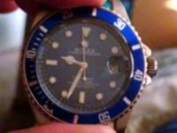Stainless steel and blue dial Rolex submariner