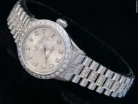 Mint condition w/over 3 ct diamond on band,dial &