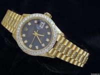 Genuine Rolex w/ 3. 50 ct diamonds on band, dial &