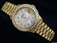 Genuine Rolex w/4 ct diamonds on the band, dial &