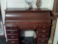 i have a nice roll top desk for sale asking 100.00 call