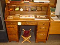 We have an attractive, reliable Roll Top Desk offered