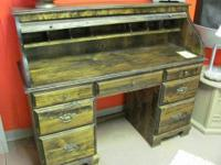 Dark pine roll top desk. Has 2 file drawers, 3
